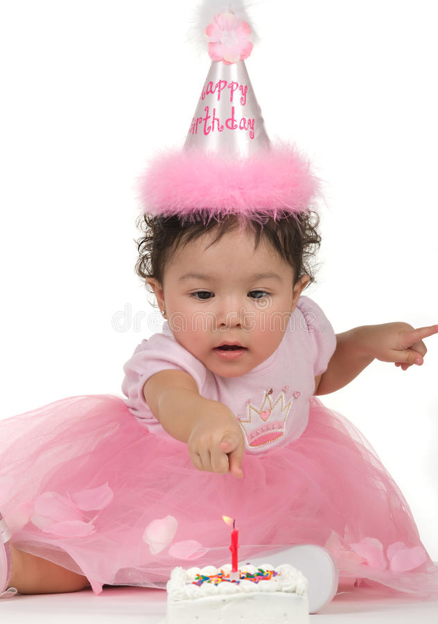 Birthday. Baby girl checking her1st birthday cake and candle stock images