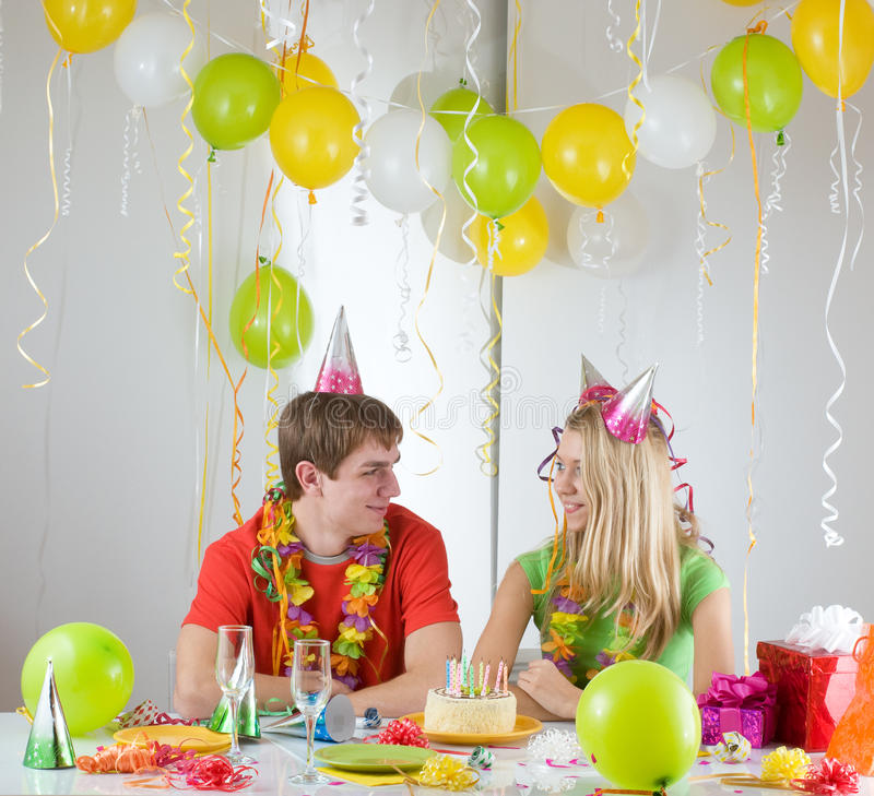 Birthday. Young happy smiling couples at birthday royalty free stock photography