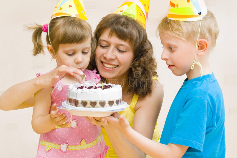 Birthday. Happy Family celebrates birthday with a cake royalty free stock images