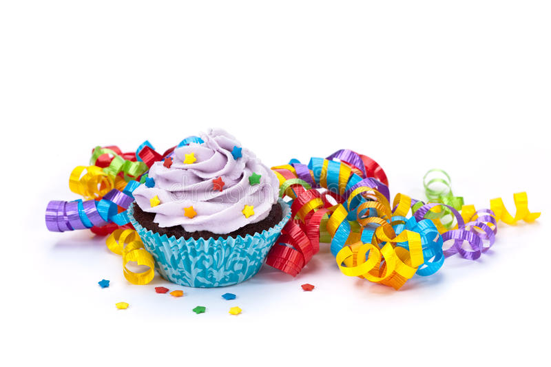 Birthday. A birthday celebration scene with ribbons and sprinkles on a white background. Copy space stock photography