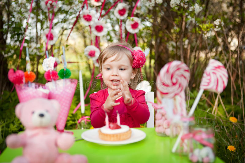 Birthday. Pink birthday of the little girl royalty free stock photos