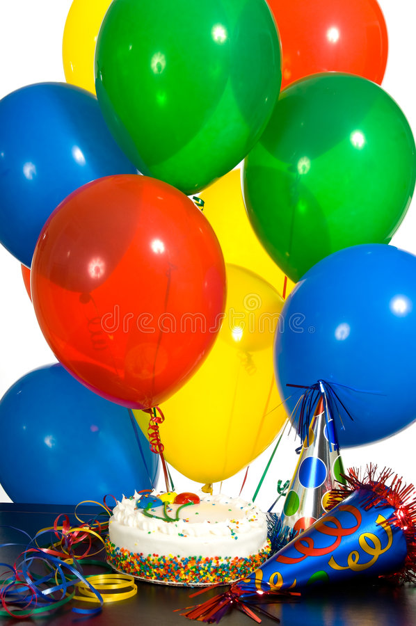 Birthday!!. Birthday celebration with ballons, a decorated cake and party hats, background royalty free stock photo