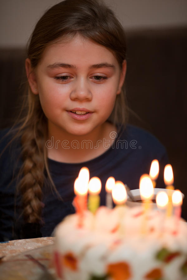Birthday. Colorful candles on birthday jelly cake in the dark. Selective focus royalty free stock image