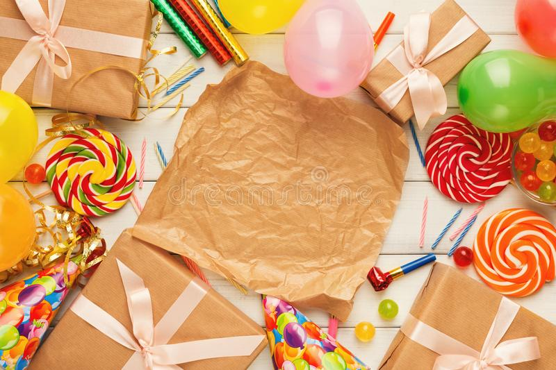 Birthday background with party hats and present box royalty free stock photography