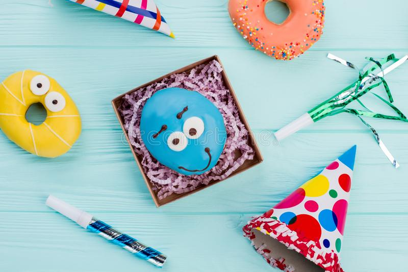 Birthday background with donuts and party items. stock photo
