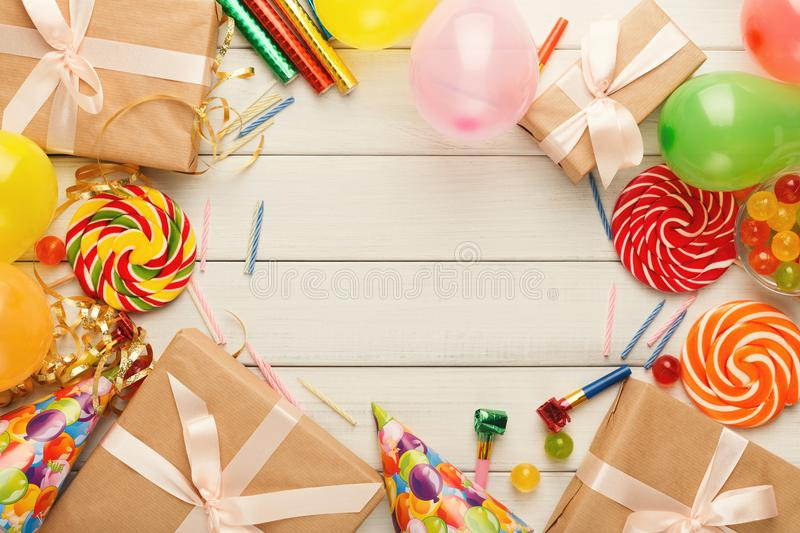 Birthday background with party hats and present box stock photo