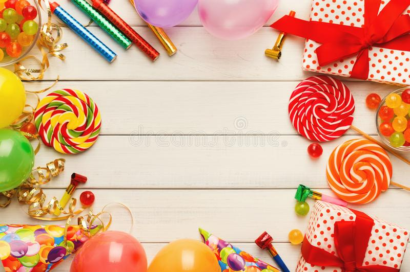 Birthday background with party hats and present box royalty free stock photos