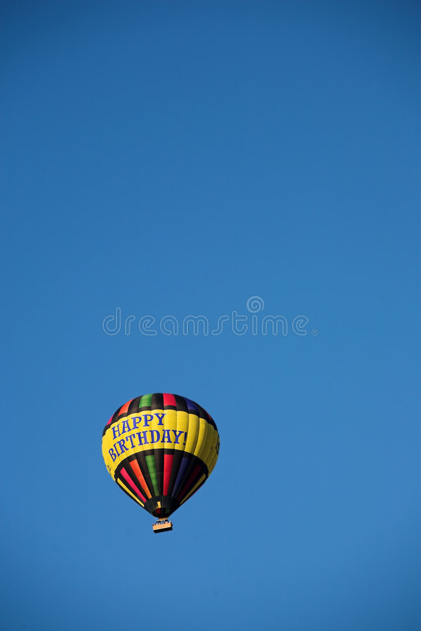 Birthday balloon. Colourful hot air balloon displaying 'Happy Birthday' against a clear blue sky royalty free stock photos