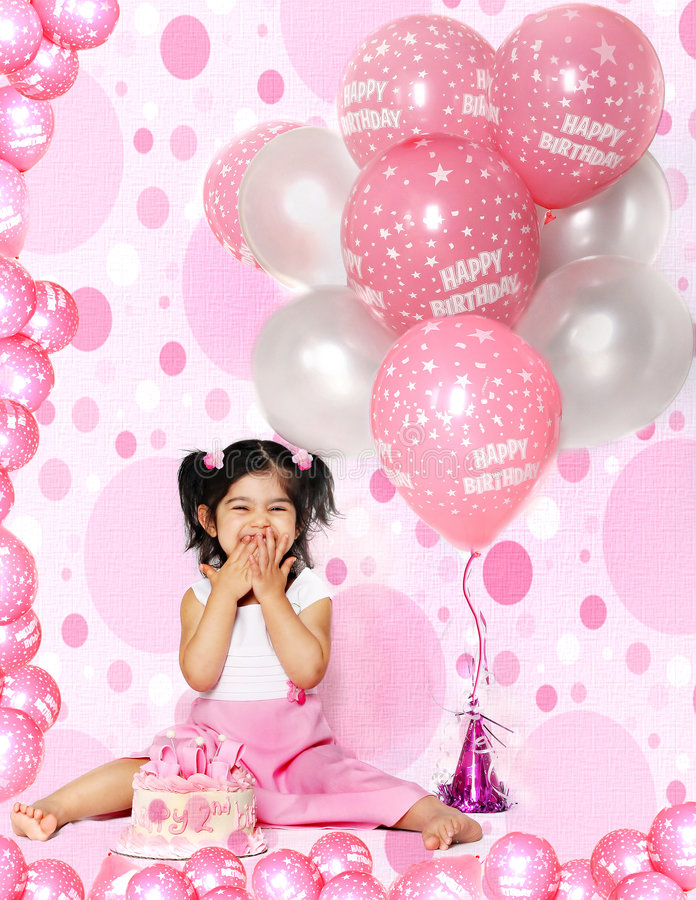 Birthday balloons. Eight pink and white birthday balloons with tons of little balloons on the floor stock photo