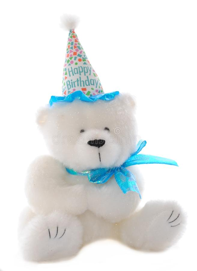 Birthday Bear. Stuffed animal for a children's birthday party sporting a hat that says Happy Birthday stock photos