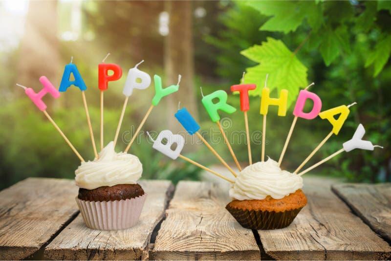 Birthday. Cake cupcake candle chocolate celebration swirl stock image