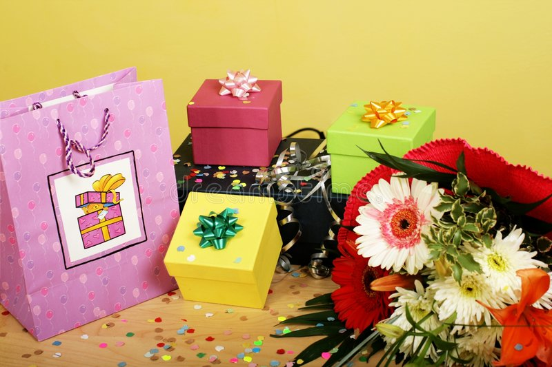 Birthday bouquet and present. Birthday celebration - bouquet and present royalty free stock photo