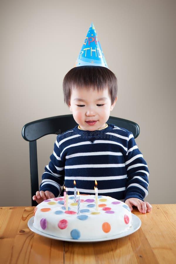 Birthday boy. A portrait of an asian boy celebrating his birthday stock photo