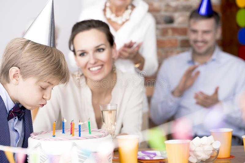 Birthday boy blowing candles stock photo