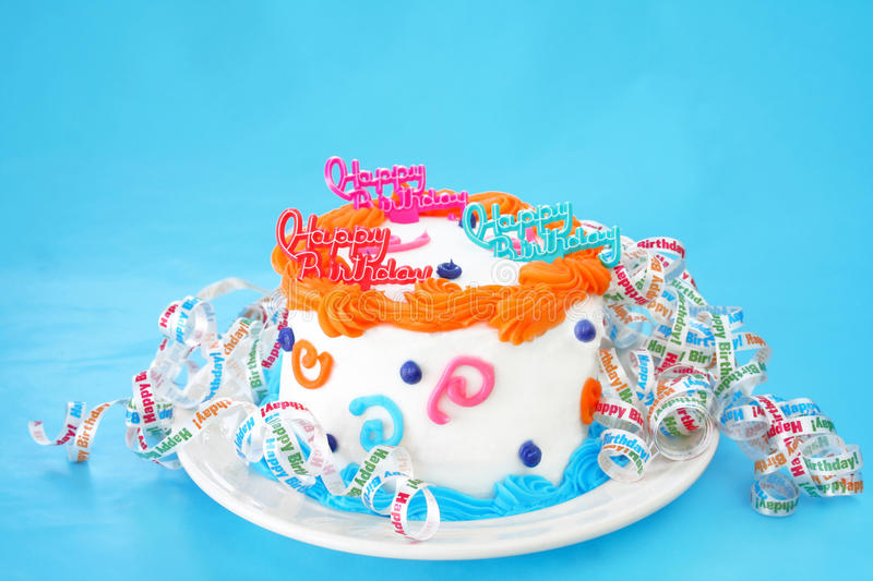 Birthday Cake. With the words Happy Birthday on top and decorated all around the cake with curly ribbons that say Happy Birthday. Room for text on the royalty free stock photography