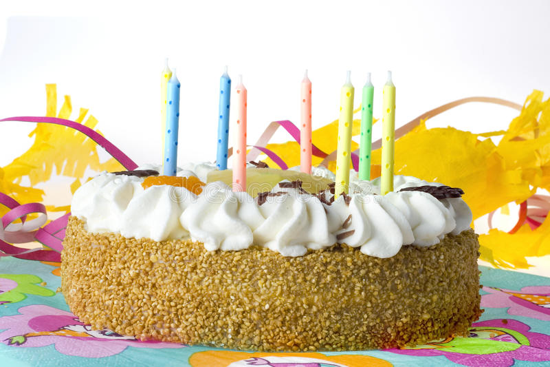 Birthday cake. A birthday cake with candles and colorful decorations stock images