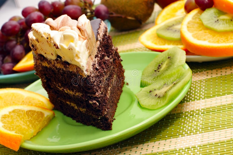 Birthday cake. With cream with fruit in the background royalty free stock photos