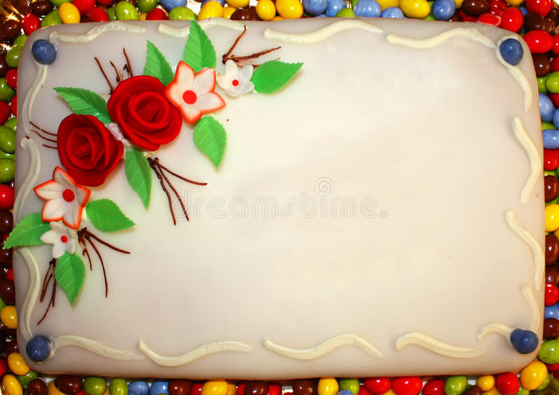 Birthday cake. With beautiful icing flowers and green leafs stock images