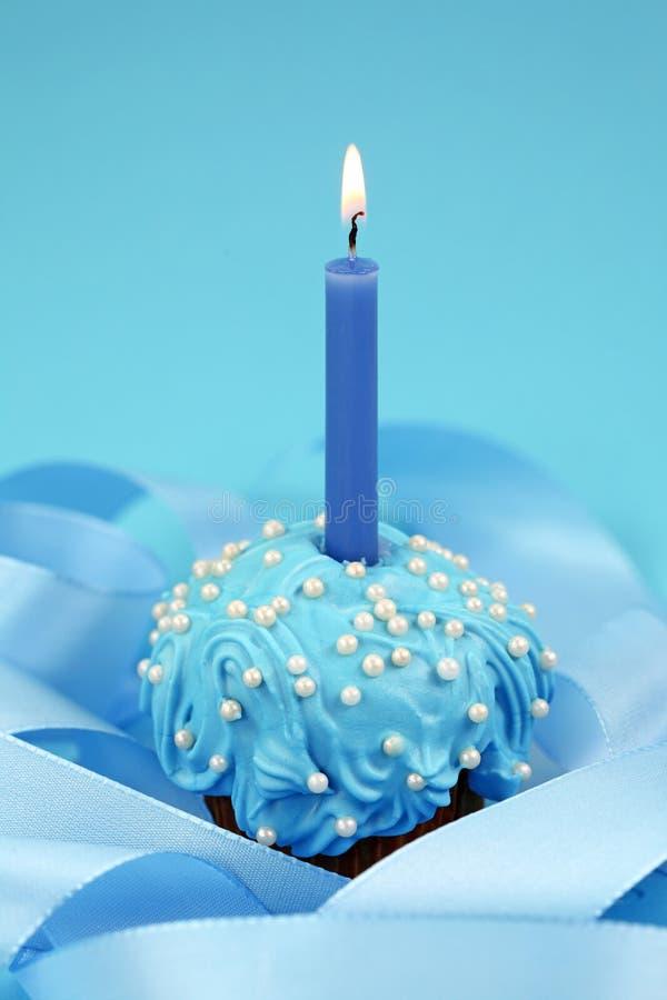 Birthday cake. On blue background royalty free stock image