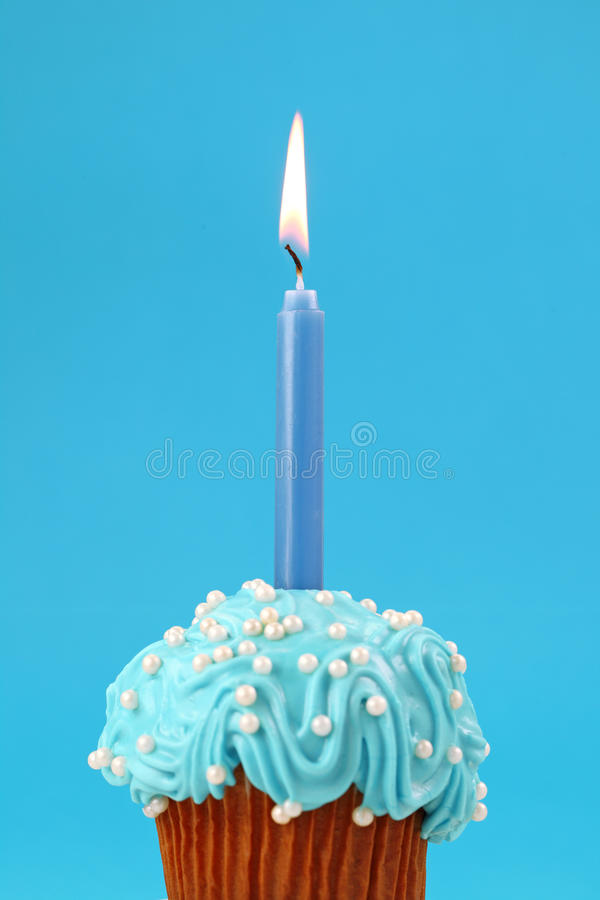 Birthday cake. On blue background royalty free stock photography