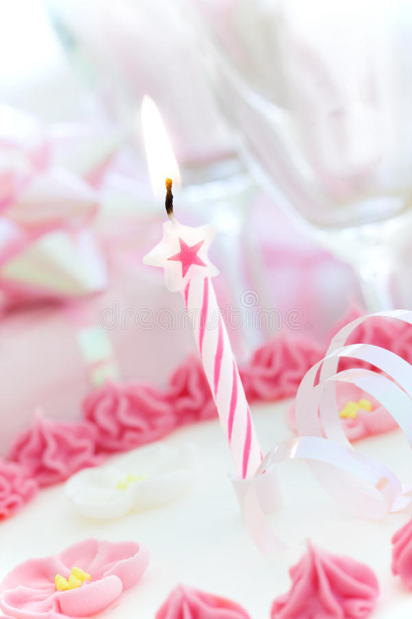 Birthday cake. Pink and white birthday cake decorated with a single candle stock photos