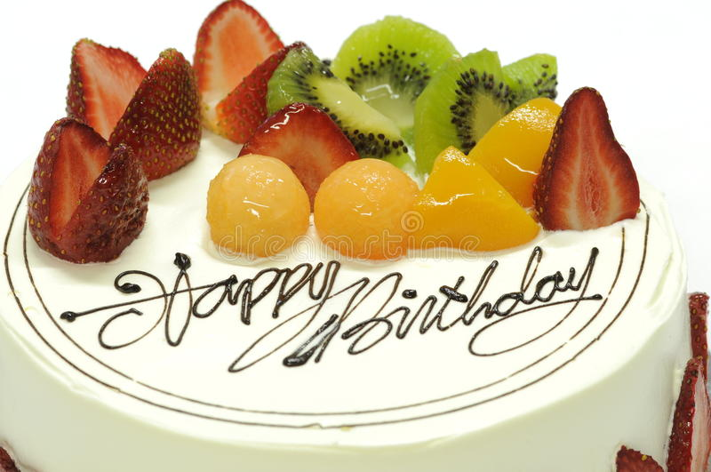 Birthday cake. Tasty colorful fruit cake with happy birthday on it stock photography