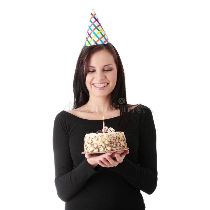Birthday cake. Beautiful young woman with birthday cake isolated on white background royalty free stock image