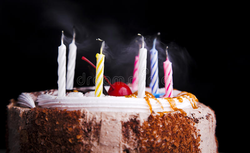 Birthday cake. With candle isolated on black stock photo