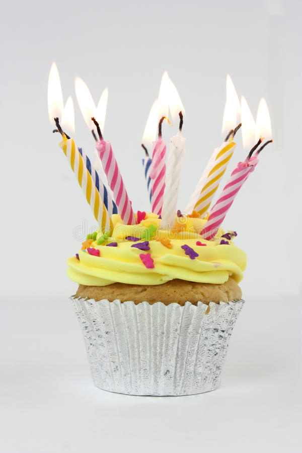 Birthday cake. Photo of a cupcake or birthday cake with lots of candles royalty free stock image