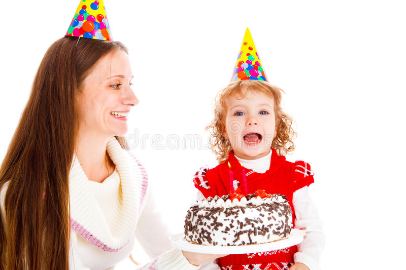 Birthday cake. Mother giving her little daughter birthday cake stock photography