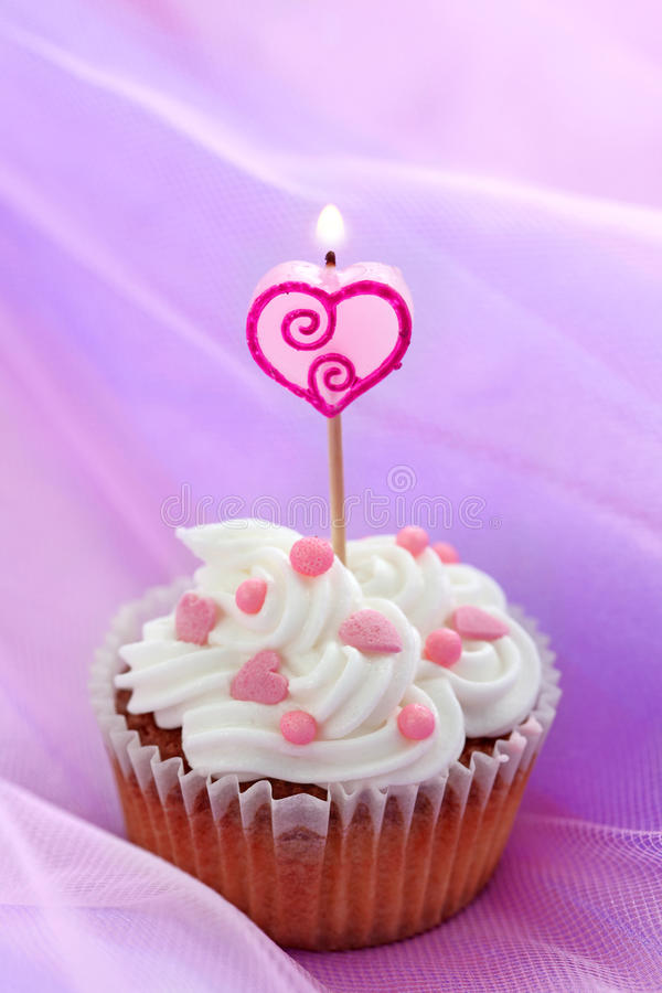Birthday cake. On lilac background royalty free stock images