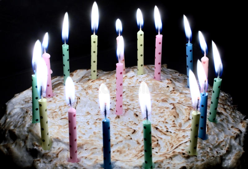Birthday cake. With burning candles stock image