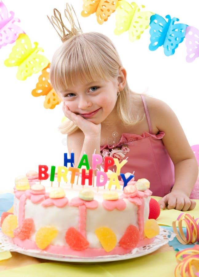 Birthday cake. Little princess and her birthday cake stock photography