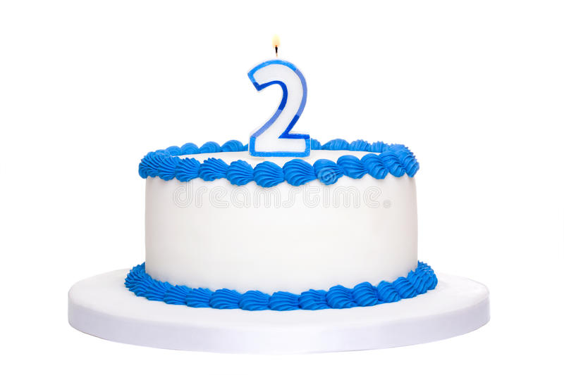 Birthday cake. Decorated with blue frosting and number two candle stock images