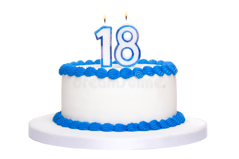 Birthday cake. Decorated with blue frosting and number eighteen candles stock photos