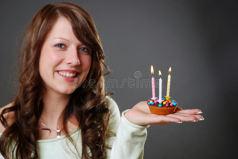Birthday cake. Smiling woman with little birthday cake royalty free stock photo