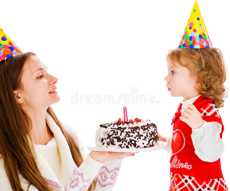 Birthday cake. Mother giving her little daughter birthday cake royalty free stock images