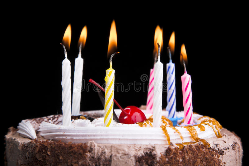 Birthday cake. With candle isolated on black royalty free stock photo
