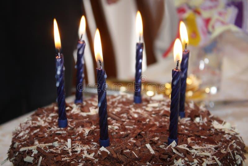 Birthday cake. Delicious chocolate birthday cake with six lit candles stock photos