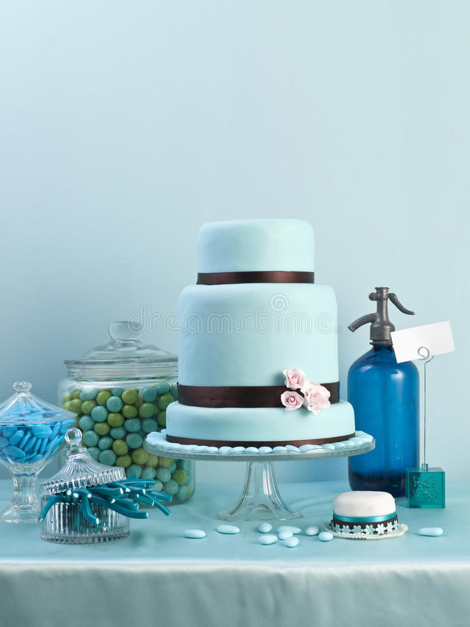 Birthday cake. Blue birthday cake with sugar, greeting card and with soda-water siphon royalty free stock photography