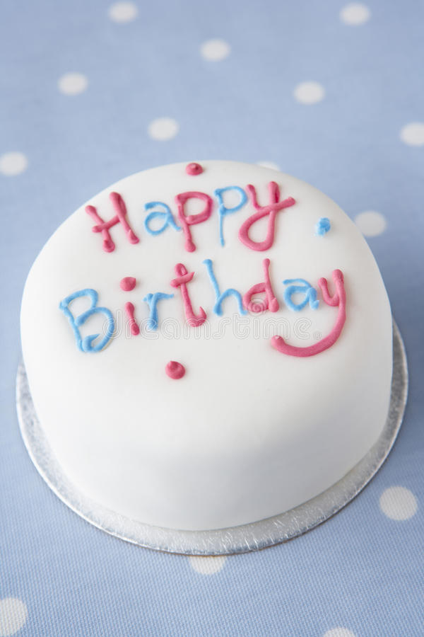A birthday cake. With white icing royalty free stock photography