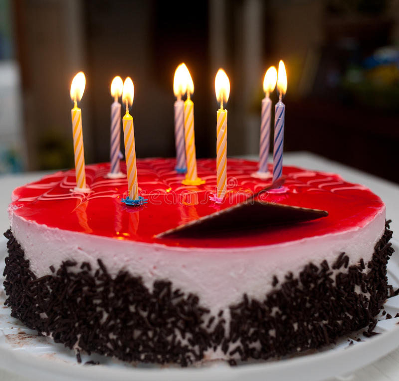 Birthday cake. With burning candles royalty free stock photography
