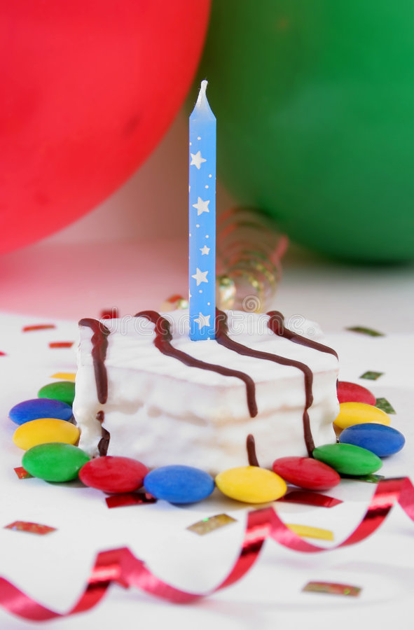 Birthday cake. With ballons and ornaments over white royalty free stock photo