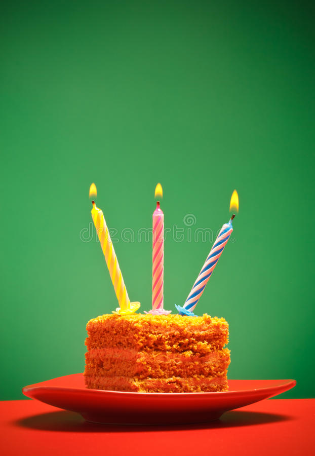 Birthday Cake. With candle on pink background royalty free stock photos