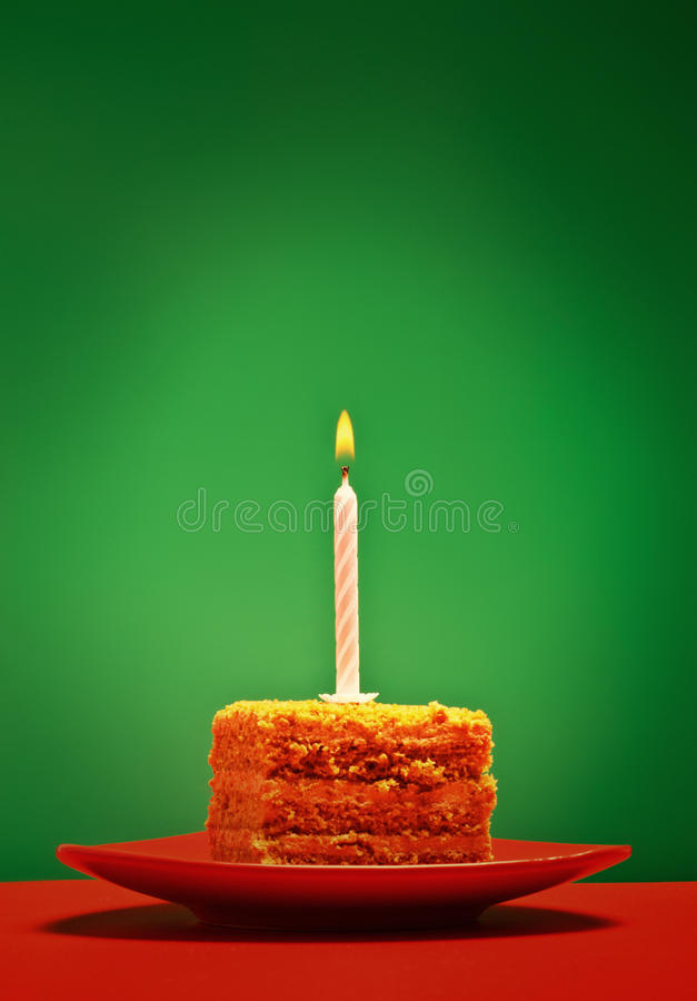Birthday Cake. With candle on pink background royalty free stock photo