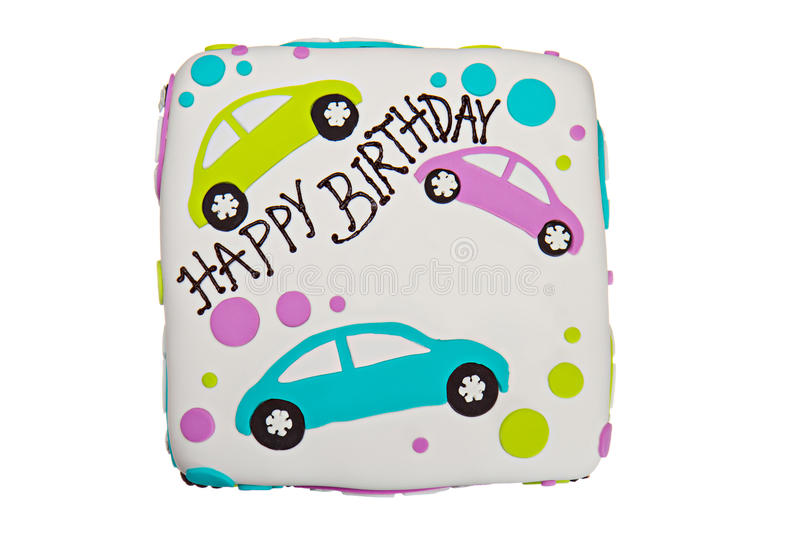 Birthday Cake. Happy birthday fondant icing cake decorated with cars and dots with a white background stock photos