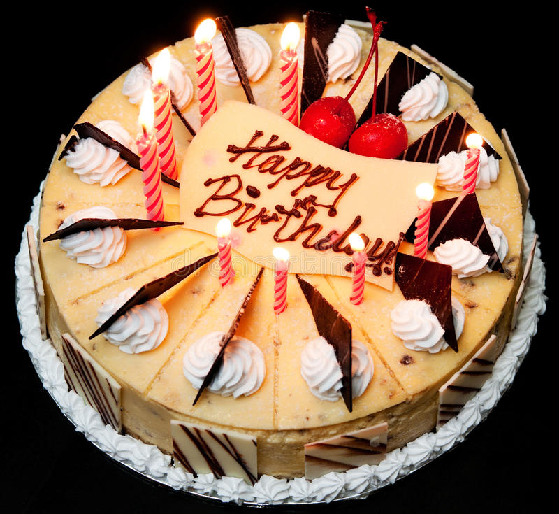 Birthday Cake. Lit with candles royalty free stock photos