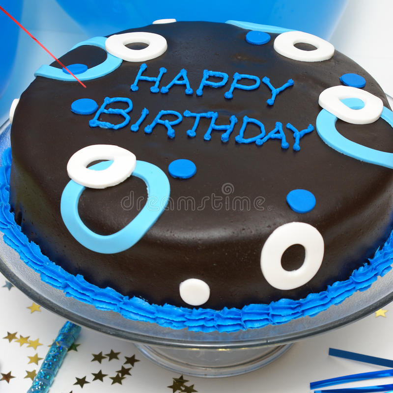 Birthday Cake. A square format shot of a birthday cake for any males special day stock photos