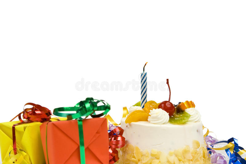 Birthday cake. White birthday cake with fruit and blue candle stock photos