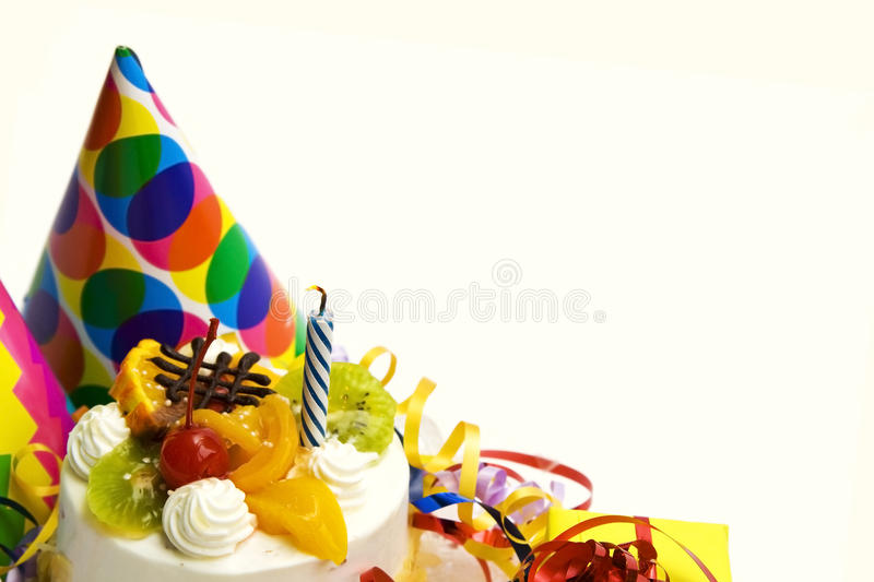 Birthday cake. White birthday cake with fruit and blue candle stock image
